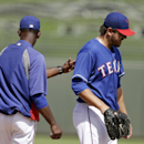 Texas Rangers manager Ron Washington takes starting pitcher Joe Saunders, right, out of the game during the second inning of a spring exhibition baseball game Sunday, March 23, 2014, in Surprise, Ariz The Associated Press