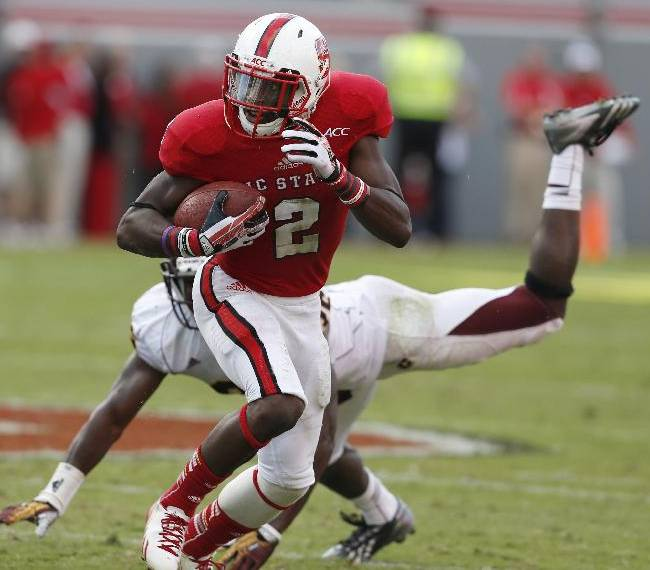 North Carolina State's Rashard Smith (2) looks for an opening during the second half of a 48-14 victory over Central Michigan in an NCAA college football game on Saturday, Sept. 28, 2013, at Carter-Finley Stadium in Raleigh, N.C