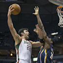 Milwaukee Bucks' Zaza Pachulia shoots the ball over Indiana Pacers' Ian Mahinmi during the first half of an NBA basketball game on Wednesday, April 9, 2014, in Milwaukee The Associated Press