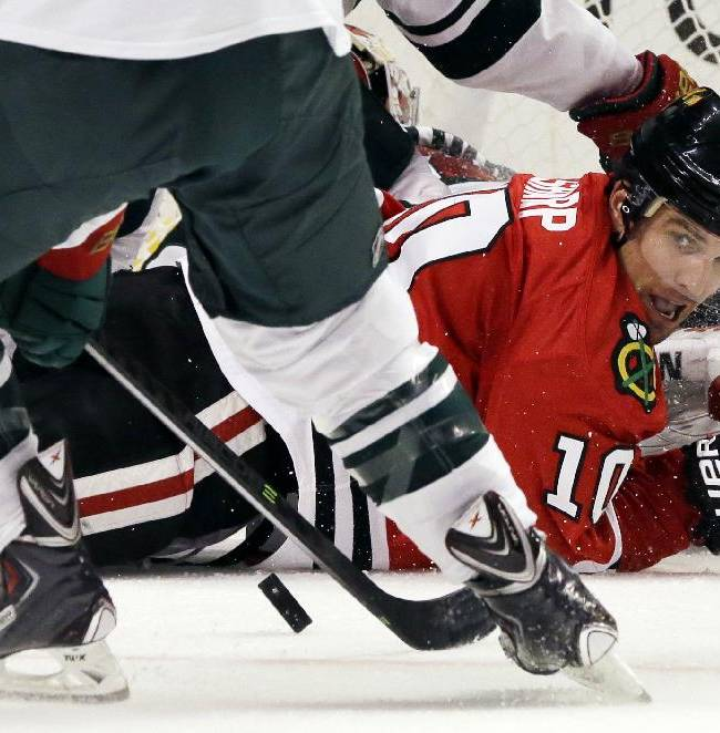 Chicago Blackhawks' Patrick Sharp (10) watches the puck after missing a goal during the second period of an NHL hockey game against the Minnesota Wild in Chicago, Saturday, Oct. 26, 2013
