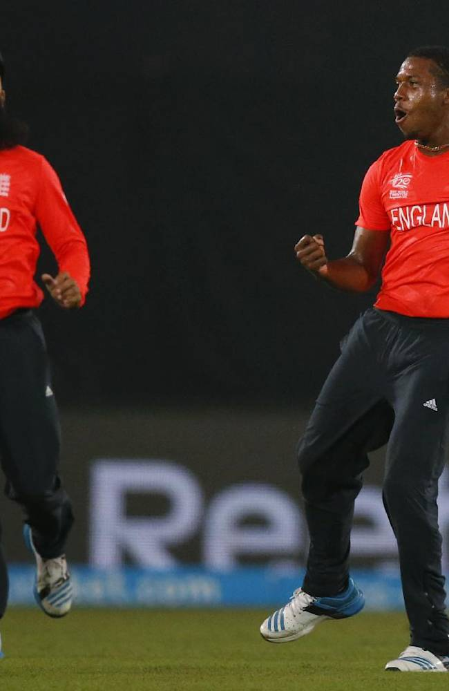 England bowler Chris Jordan, right,  celebrates with teammate Moeen Ali the dismissal of India's batsman Yuvraj Singh during their ICC Twenty20 Cricket World Cup warm up match in Dhaka, Bangladesh, Wednesday, March 19, 2014