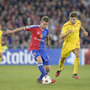 Basel's Fabian Frei, left, fights for the ball against Liverpool's Steven Gerrard, during a Champions League group B match between Switzerland's FC Basel 1893 and Britain's Liverpool FC in the St. Jakob-Park stadium in Basel, Switzerland, Wednesday, Oct.