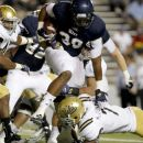 Rice running back Jeremy Eddington (30) is tackled by UCLA safety Ricky Marvray during the second half of an NCAA college football game, Thursday, Aug. 30, 2012, in Houston. UCLA won 49-24. (AP Photo/Eric Kayne)