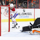 Montreal Canadiens' Tomas Plekanec, of the Czech Republic, tips the puck into the net for a goal behind Philadelphia Flyers' Ray Emery during the third period of an NHL hockey game, Saturday, Oct. 11, 2014, in Philadelphia. The Canadians won 4-3 in a shoo
