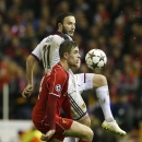 Liverpool's Jordan Henderson, left, challenges Basel's Shkelzen Gashi during the Champions League Group B soccer match between Liverpool and FC Basel at Anfield Stadium in Liverpool, England, Tuesday, Dec. 9, 2014