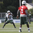 New York Jets wide receiver Jalen Saunders (16) catches a pass from quarterback Michael Vick (1) at practice during NFL football training camp Friday, July 25, 2014, in Cortland, N.Y. (AP Photo) The Associated Press