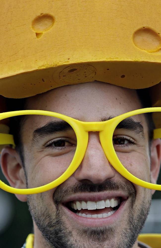 Brian Falasca of Washington, DC., wears a cheesehead and glasses outside Lambeau Field before an NFL football game between the Green Bay Packers and the Washington Redskins Sunday, Sept. 15, 2013, in Green Bay, Wis