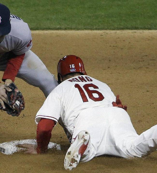 St. Louis Cardinals' Kolten Wong steals second with Boston Red Sox's Xander Bogaerts covering during the eighth inning of Game 3 of baseball's World Series Saturday, Oct. 26, 2013, in St. Louis
