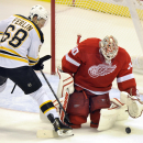 Detroit Red Wings goalie Jonas Gustavsson, right, of Sweden, blocks the shot of Boston Bruins right wing Brian Ferlin during the third period of an NHL hockey game in Detroit, Saturday, Sept. 27, 2014. The Bruins won 3-1. The Associated Press