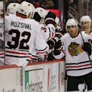 Chicago Blackhawks right wing Patrick Kane, right, is congratulated by teammates after he scored the go-ahead goal against the Colorado Avalanche in the third period of the Blackhawks' 3-2 victory in an NHL hockey game in Denver on Wednesday, Nov. 26, 201