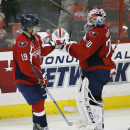 Washington Capitals center Nicklas Backstrom (19), from Sweden, celebrates his third goal for a hat trick with goalie Braden Holtby (70), in the third period of an NHL hockey game against the Tampa Bay Lightning, Saturday, Dec. 13, 2014, in Washington. Th