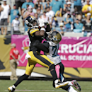 Pittsburgh Steelers wide receiver Antonio Brown, left, catches a pass as he is defended by Jacksonville Jaguars cornerback Will Blackmon during the second half of an NFL football game in Jacksonville, Fla., Sunday, Oct. 5, 2014 The Associated Press