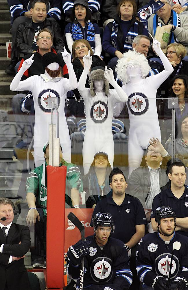 Winnipeg Jets' fans cheer in the stands during a game against the Toronto Maple Leafs in NHL action at the MTS Centre on December 31, 2011 in Winnipeg, Manitoba, Canada. (Photo by Marianne Helm/Getty Images)