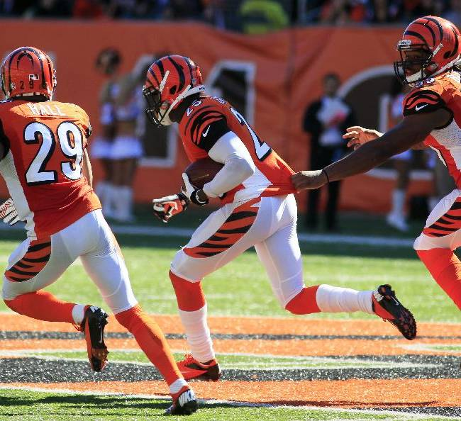 Cincinnati Bengals cornerback Terence Newman (23) returns a fumble for a 58 yard touchdown with Leon Hall (29) and Vontaze Burfict (55) in the second half of an NFL football game against the Green Bay Packers, Sunday, Sept. 22, 2013, in Cincinnati