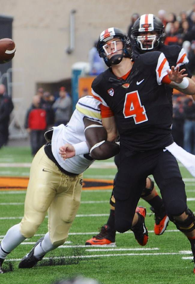 Oregon State's quarterback Sean Mannion (4) loses the ball in a tackle by Colorado's Chidera Uzo-Diribe (96) in the first half of an NCAA college football game on Saturday, Sept 28, 2013, in Corvallis, Ore