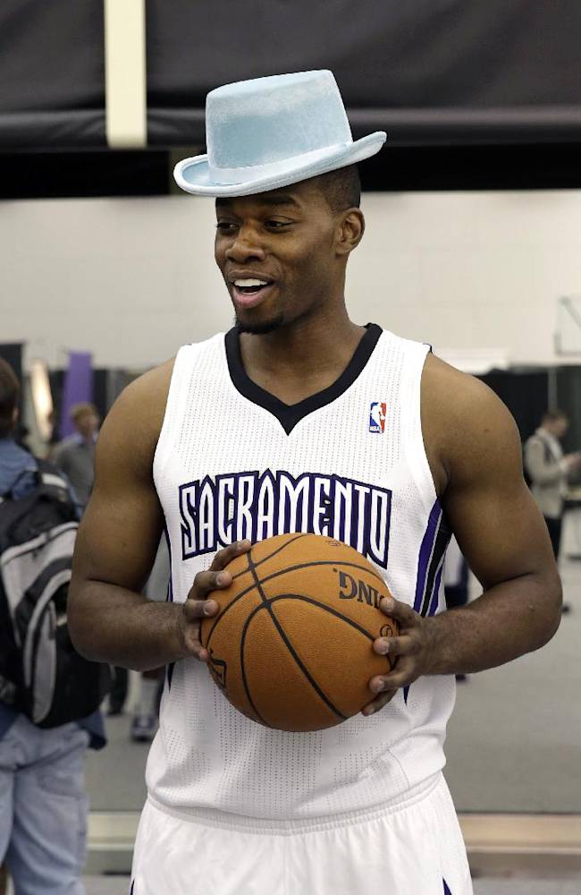 Sacramento Kings forward Carl Landry dons a top hat during the team's NBA basketball media day in Sacramento, Calif., Monday, Sept. 30, 2013