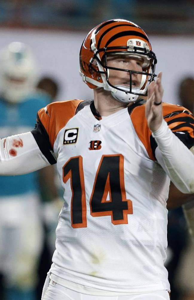 Cincinnati Bengals quarterback Andy Dalton looks to pass during the first half of an NFL football game against the Miami Dolphins, Thursday, Oct. 31, 2013, in Miami Gardens, Fla