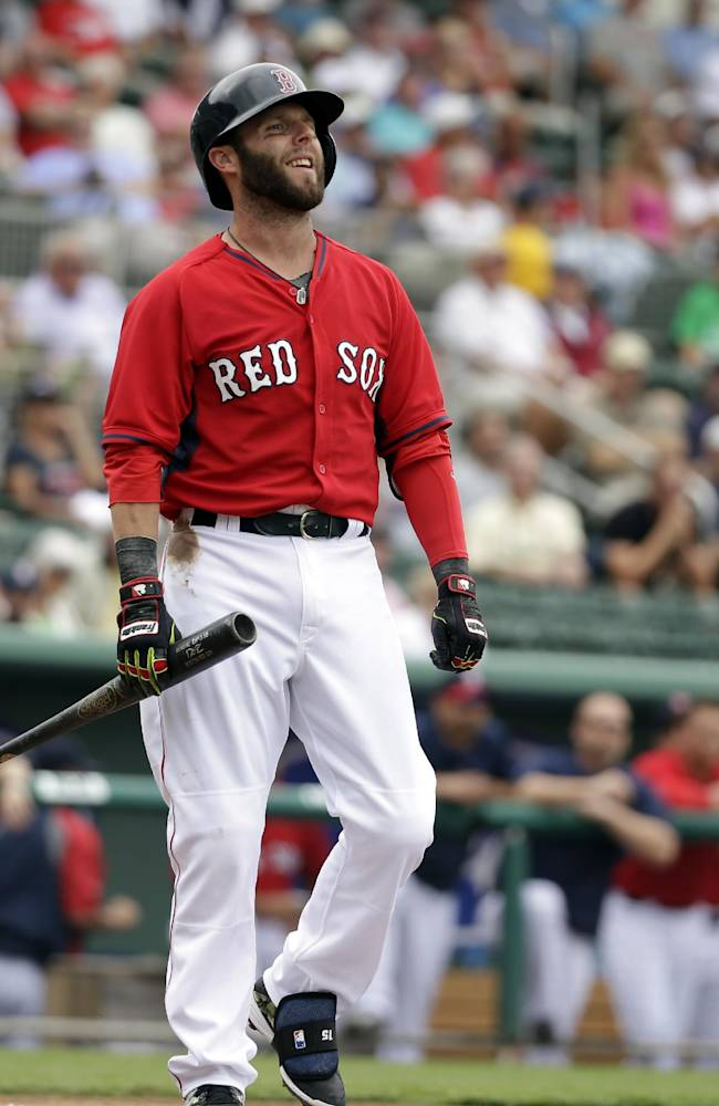 Boston Red Sox's Dustin Pedroia smiles after swinging at and missing a pitch by Northeastern pitcher Dustin Hunt in the first inning of an exhibition baseball game Thursday, Feb. 27, 2014, in Fort Myers, Fla