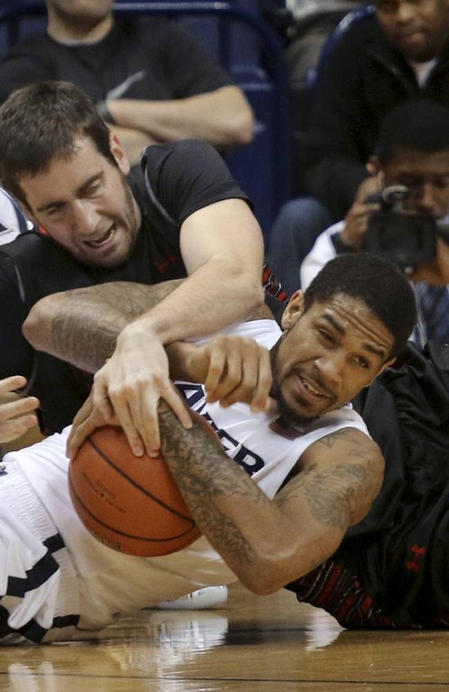 Xavier's Justin Martin tries to keep a loose ball from Gardner-Webb's Mike Byron in the first half of an NCAA college basketball game in Cincinnati on Friday, Nov. 8, 2013