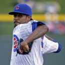 Chicago Cubs' Edwin Jackson throws before the first inning of an spring exhibition baseball game against the Kansas City Royals, Sunday, March 2, 2014, in Mesa, Ariz The Associated Press