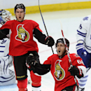 Ottawa Senators' Mike Hoffman (68) celebrates his goal with Mark Stone (61) as Maple Leafs' Roman Polak(46) and goaltender James Reimer (34) look away during the first period of an NHL hockey game in Ottawa, Ontario, Sunday, Nov. 9, 2014 The Associated Pr