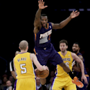 Phoenix Suns guard Eric Bledsoe, right, guards Los Angeles Lakers guard Steve Blake during the second half of an NBA basketball game in Los Angeles, Tuesday, Dec. 10, 2013 The Associated Press