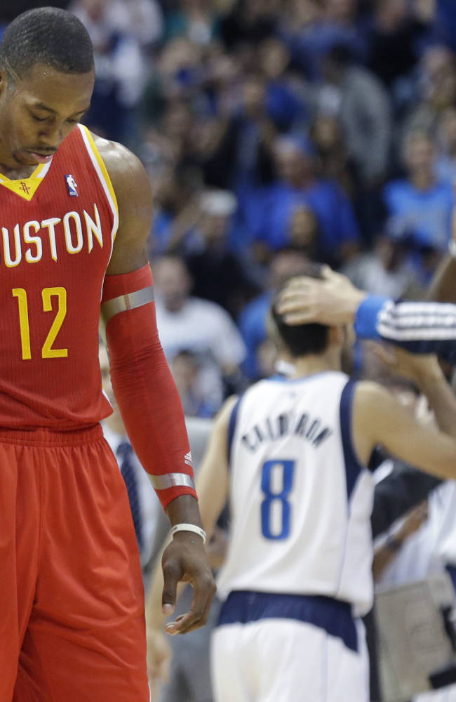Houston Rockets forward Dwight Howard (12) hangs his head as he walks to  the bench during a time out in the fourth quarter of an NBA basketball game against the Dallas Mavericks in Dallas,  Wednesday, Nov. 20, 2013. The Mavericks won 123-120