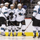 San Jose Sharks' Joe Pavelski (8) celebrates his goal against the Arizona Coyotes with teammates Joe Thornton (19), Patrick Marleau (12), Brent Burns (88) and Logan Couture (39) during the second period of an NHL hockey game Tuesday, Jan. 13, 2015, in Gle