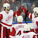 Detroit Red Wings' Darren Helm (43) celebrates his goal with Brendan Smith (2) along with Luke Glendening (41) and Drew Miller (20) during the third period of an NHL hockey game against the Buffalo Sabres in Buffalo, N.Y., Tuesday, April 8, 2014. Detroit