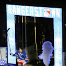 New York Rangers captain Ryan McDonagh (27) raises his stick to salute the fans as he is introduced before the NHL hockey game against the Toronto Maple Leafs on opening night at Madison Square Garden on Sunday, Oct. 12, 2014, in New York The Associated