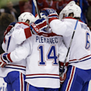 Montreal Canadiens players, including center Tomas Plekanec (14), of the Czech Republic, and defenseman Douglas Murray (6), celebrate a goal against the Tampa Bay Lightning by right winger Brendan Gallagher during the first period of an NHL hockey game Tu