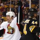Ottawa Senators' David Legwand celebrates his game-tying goal during the third period of the Senators 3-2 shootout win over the Boston Bruins in an NHL hockey game in Boston Saturday, Dec. 13, 2014. (AP Photo/Winslow Townson)