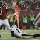 Atlanta Falcons wide receiver Julio Jones (11) moves after making a catch against New Orleans Saints cornerback Patrick Robinson (21) during the second half of an NFL football game, Sunday, Sept. 7, 2014, in Atlanta The Associated Press