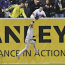 Colorado Rockies left fielder Carlos Gonzalez goes up to snare a deep drive hit by San Diego Padres' Nick Hundley with a runner on base in the seventh inning of a baseball game Tuesday, April 15, 20