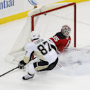 New Jersey Devils goalie Cory Schneider, right, makes a save against Pittsburgh Penguins center Sidney Crosby during the third period of an NHL hockey game, Friday, Jan. 30, 2015, in Newark, N.J. The Penguins won 2-1 in overtime The Associated Press