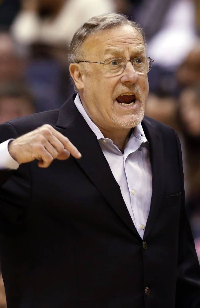 Minnesota Timberwolves head coach Rick Adelman questions an officials' call in the first half of an NBA basketball game against the Washington Wizards Tuesday, Nov. 19, 2013, in Washington. The Wizards won 104-100
