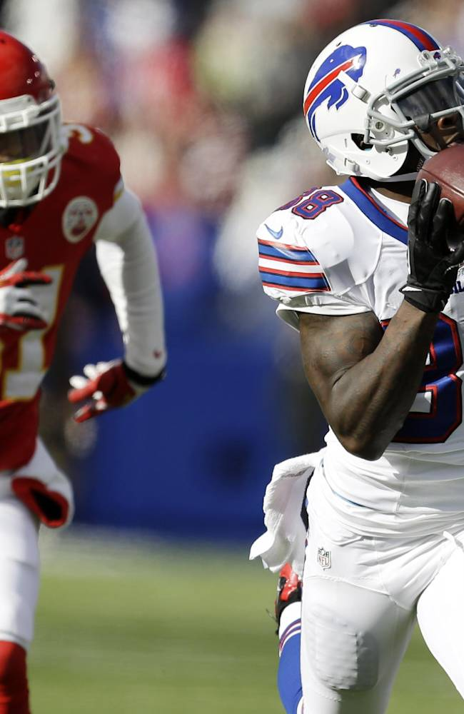 Buffalo Bills wide receiver Marquise Goodwin (88) hauls in a pass as Kansas City Chiefs cornerback Marcus Cooper (31) attempts to defend on the 59-yard touchdown run during the first quarter of an NFL football game in Orchard Park, N.Y., Sunday, Nov. 3, 2013