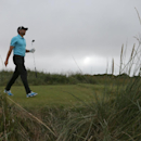Sergio Garcia of Spain walks off the 13th tee box during the final round of the British Open Golf championship at the Royal Liverpool golf club, Hoylake, England, Sunday July 20, 2014