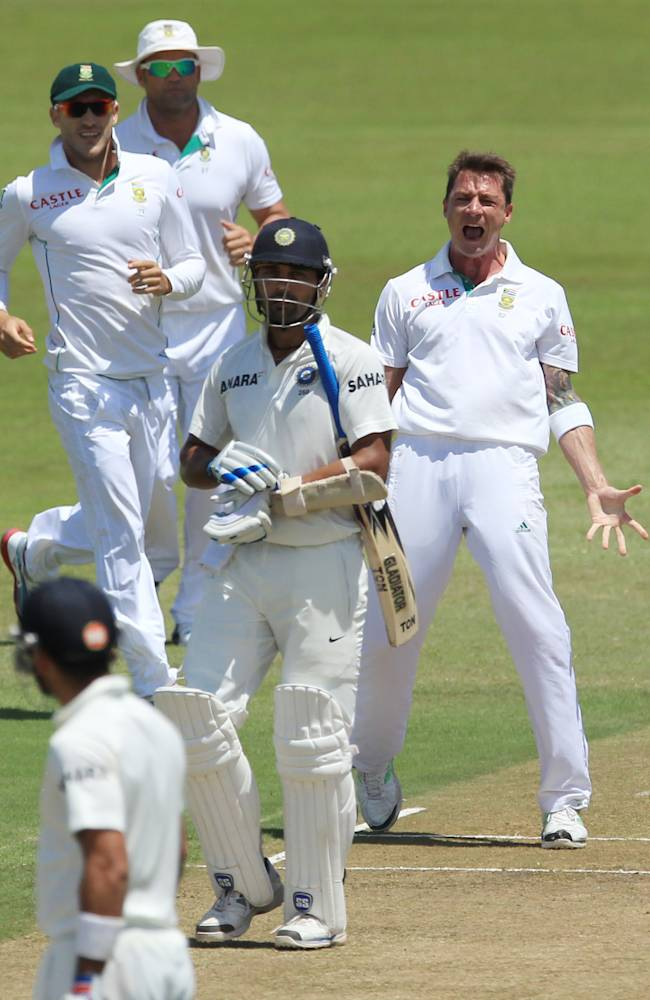 South Africa's bowler Dale Steyn, right, reacts after dismissing India's batsman Murali Vijay, second from right, for 97 runs during second day of their cricket test match at Kingsmead stadium, Durban, South Africa, Friday, Dec. 27, 2013