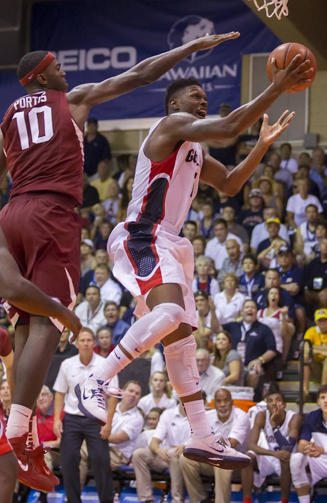 Gonzaga guard Gary Bell, Jr., right, gets by Arkansas forward Bobby Portis (10) to shoot a layup in the second half of an NCAA college basketball game at the Maui Invitational on Wednesday, Nov. 27, 2013, in Lahaina, Hawaii. Gonzaga beats Arkansas 91-81
