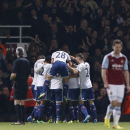 Chelsea s players celebrate Frank Lampard s goal against West Ham United during their English Premier League soccer match at Upton Park, London, Saturday, Nov. 23, 2013