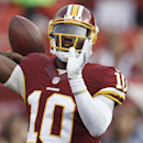 Washington Redskins quarterback Robert Griffin III warms up before an NFL football preseason game against the New England Patriots in Landover, Md., Thursday, Aug. 7, 2014 The Associated Press