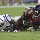 Houston Texans' Andre Johnson (80) fumbles as he is defended by Indianapolis Colts' Vontae Davis (21) during the second half of an NFL football game, Thursday, Oct. 9, 2014, in Houston. Indianapolis recovered the ball The Associated Press