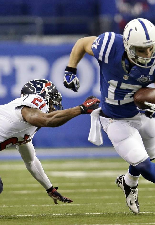 Indianapolis Colts receiver Griff Whalen, right, gets past Houston Texans cornerback Brice McCain after making a catch during the first half of an NFL football game in Indianapolis, Sunday, Dec. 15, 2013