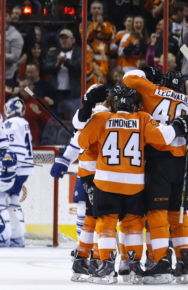 Philadelphia Flyers' Kimmo Timonen (44), of Finland, and Vincent Lecavalier (40) celebrate with teammates after Lecavalier's goal during the first period of an NHL hockey game against the Toronto Maple Leafs, Friday, March 28, 2014, in Philadelphia