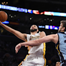 Los Angeles Lakers guard Kendall Marshall, left, puts up a shot as Memphis Grizzlies center Marc Gasol, of Spain, defends during the first half of an NBA basketball game, Sunday, April 13, 2014, in Los Angeles The Associated Press