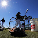 Pittsburgh Pirates catcher Russell Martin, center, warms up for his turn in the batting cage during a baseball spring training practice in Bradenton, Fla., Sunday, Feb. 16, 2014 The Associated Press