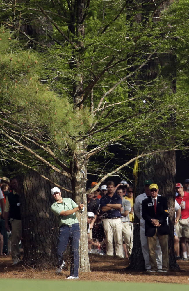 Jordan Spieth hits out of the rough off the 13th fairway during the fourth round of the Masters golf tournament Sunday, April 13, 2014, in Augusta, Ga