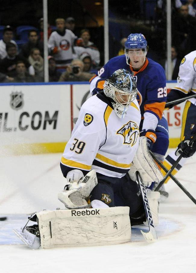 Poulin has 32 saves, Islanders beat Predators 3-1