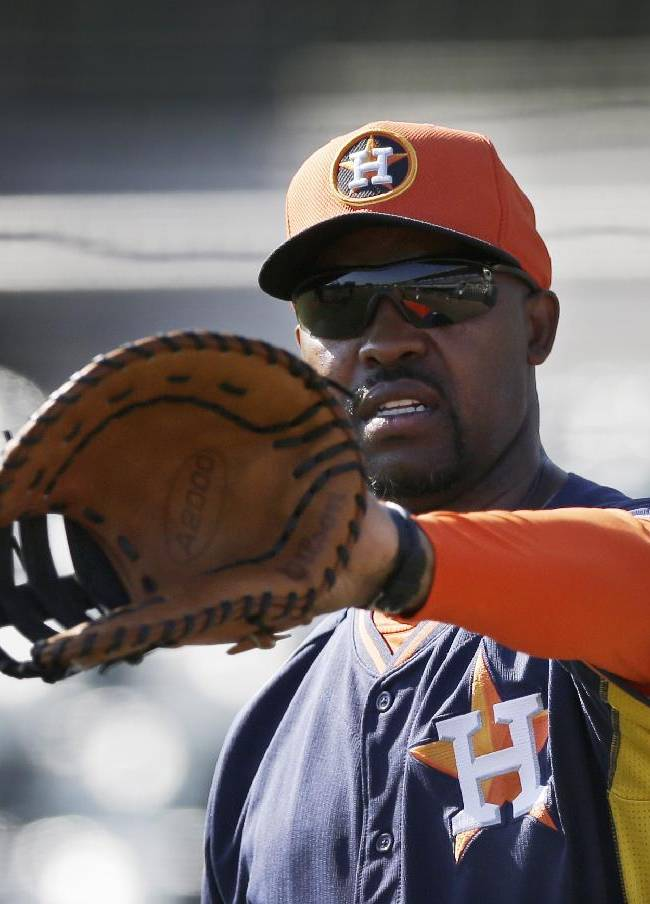 Houston Astros manager Bo Porter catches before a spring training baseball game against the Toronto Blue Jays in Kissimmee, Fla., Sunday, March 9, 2014